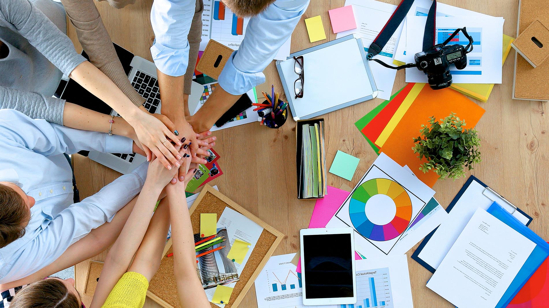 Business team with hands together – teamwork concepts